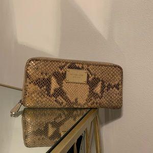michael kors python wallet matching the purse.